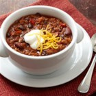 Hearty Beef and Two-Bean Chili - Ready to serve in under an hour, this tasty chili with black beans and red kidney beans in a flavorful spicy sauce makes a hearty meal on a chilly day.
