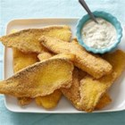 Pan Fried Fish with Cajun Tartar Sauce - Cornmeal dusted fish fillets are pan fried until golden brown and served with a spicy Cajun-seasoned tartar sauce.