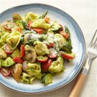 Pesto Primavera Tortellini with Chicken - Colorful roasted vegetables are mixed with cheese tortellini, chopped pan-fried chicken breasts, and homemade basil pesto for a complete meal-in-one dish.