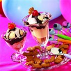 S'More Sundae - Your favorite camp treat in the form of an ice cream sundae! Crumbled graham crackers are topped with ice cream, hot fudge, and marshmallow ice cream topping for a sweet summer treat.