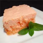 Orange Buttermilk Salad - A refreshing chilled salad with orange gelatin, pineapple, buttermilk, and whipped topping.