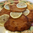 Schnitzel with a Twist - Pork chops, pounded not-too-thin, are pan fried with a butter cracker crust.