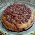 Topsy-Turvy Apple Pie - For this clever creation, butter and pecans are put into the pie pan before the bottom pastry. After the pie is completely filled with sweet, spiced apples, topped with a second crust and baked, the entire pie is flipped to reveal a luxurious pecan glaze.