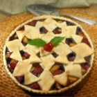 Cherry Berry Peach Pie - Use your summer peaches, blueberries, and cherries to create a colorful lattice-top pie to enjoy with a scoop of vanilla ice cream on a hot summer evening.