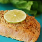 Spicy Garlic Salmon - Salmon fillets are baked with a delicious garlic and mustard paste. Quick, easy, and delicious!