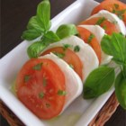 Tomato Mozzarella Salad - Mozzarella slices are served with tomatoes, fresh basil, and sprinkled with olive oil. A perfect salad alternative, especially in summer when you can get tomatoes and basil from the garden.