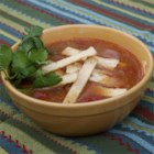 Healthier Slow-Cooker Chicken Tortilla Soup - This quick and easy chicken tortilla soup is made even healthier than the original by using skinless chicken strips, reduced-sodium chicken broth, and a lot of additional veggies for a flavorful and colorful topping.
