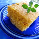 Applesauce Cornbread - This is an easy, quick recipe for cornbread that's dense, and adjustably sweet. It will smell great as it bakes and comes out with a great golden crust. It can accompany anything. I love it served with salad, soup, or chili.  Add herbs for extra flavor.