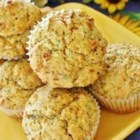 Savory Zucchini Muffins - A savory muffin with zucchini, onion, roasted red peppers, and sun-dried tomatoes is a nice change from the usual sweet zucchini muffin.