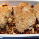 Baked Chicken with Apple Stuffing - Breaded chicken breasts are baked with a simple apple and bread stuffing for an easy one dish meal. Get cozy with this holiday-inspired meal anytime of year!
