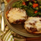 Pizza Buns - Fun individual pizzas on burger buns, made with ground beef and seasoned pizza sauce, are topped with mozzarella cheese for that real pizza taste. Best of all, they're quick and so easy to make.