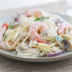 Savoury Shrimp Linguine - A creamy garlic sauce with shrimp, mushrooms, and snow peas elevates this weeknight pasta dish to delicious!