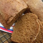 Best Ever Pumpernickel Loaf - Wheat and rye flour, cocoa powder, and molasses are baked together creating a perfect pumpernickel bread. Serve with honey butter.