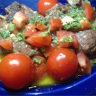 Mint-Tomato Sauce for Lamb - Fresh tomatoes and mint are whisked together with extra virgin olive oil and white wine vinegar in this refreshing sauce.