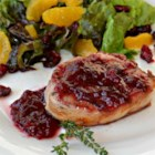 Pork Cutlets with Cranberry Wine Sauce - Pork chops are browned then served in a cranberry and white wine sauce with fresh herbs. This is a quick and easy meal that is suitable for company or a weeknight dinner.