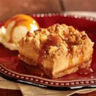 Caramel Apple Streusel Squares - On a brown sugar-rolled oats crust, apples in a creamy caramel sauce are topped with a streusel mixture, baked, then served warm with ice cream.