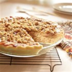 Caramel Apple Walnut Pie - Apples in a sweet, creamy base are topped with a walnut crumble and baked until apples are tender and topping is golden brown.