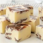 Chocolate Swirled Peppermint Fudge - Chunks of minty chocolate are sprinkled liberally throughout this easy white fudge.