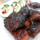 Simple Country Ribs - Ribs are boiled in barbeque sauce before grilling to keep them extra tangy, tasty and moist!