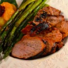 Marinated Grilled Pork Tenderloin - Pork tenderloin is marinated with soy sauce, oyster sauce, honey, and ginger in this easy outdoor dish. Serve it with your favorite salad for a tasty dinner.