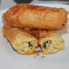 Deluxe Egg Rolls - Ground turkey and vegetables cooked in ginger, garlic and soy sauce make a great filling for delicious deep fried egg rolls.