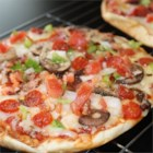 Pita Pizza - All you need is mozzarella cheese, sliced veggies, olive oil, pita pockets, and a grill. Brush the pita with oil, layer on the veggies and cheese, and then grill until the pita is crisp, the veggies are tender and the cheese is melted.