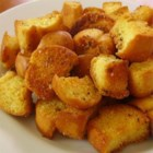Old Hamburger Bun Croutons - Convert leftover hamburger buns to croutons for a money- and food-saving item it never hurts to have on hand.
