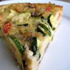 Zucchini Tomato Pie - Zucchini, tomato and onion combined with Parmesan cheese and baked with milk and biscuit mix.