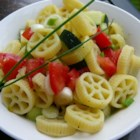 Pickled Mostaccioli - Marinated pasta in a sweet and sour sauce.  Can be made ahead and will last up to two weeks.  Our family loves this recipes. Great for BBQ parties or any family event.