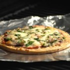 California Grilled Pizza - Cook a fresh pizza topped with mushrooms, onion, and marinated artichoke hearts right on the grill in just minutes using a prebaked pizza crust on sheets of foil to keep everything nice and neat. This recipe makes 2 delicious pizzas.