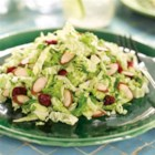 Cranberry Almond Crunch Slaw - Sour cream or plain yogurt replaces mayonnaise in a light creamy dressing for this updated take on traditional coleslaw.