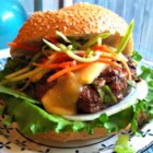 Asian Barbecue Burgers - These grilled beef burgers include the Asian flavors of hoisin, Sriracha sauce, and sesame oil with a little crushed red pepper for some added heat.