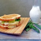 Tubby's Pesto Panini - A thick layer of homemade pesto adds a fresh herbal flavor to this smoked mozzarella and grilled chicken panini.