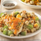Skillet Chicken and Apple Stuffing - Tender, browned chicken breasts are served atop stuffing with lots of celery and apples, and sprinkled with Cheddar cheese.