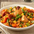 Quick Chicken Paella - Chunks of chicken and chorizo slices are cooked with a colorful blend of veggies until just done, then blended with white rice and broth for a quick and tasty weeknight dinner.