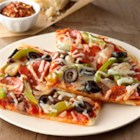 Pizza Supreme - Pizza's ready in half an hour when you use a pre-baked crust, pizza sauce, and a handy blend of prepared green peppers, mushrooms, olives, and onions.