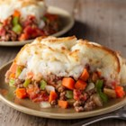 Shepherd's Pie from Birds Eye(R) - Browned ground beef, diced tomatoes, and mixed veggies are simmered on the stove, then placed in a casserole, topped with prepared mashed potatoes, and baked until golden for this easy, comfort-food classic.