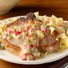Smothered Pork Chops from Birds Eye(R) - Browned pork chops are simmered in a creamy sauce with lots of veggies, then served over noodles or mashed. potatoes.