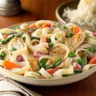 Chicken 'N Pasta Primavera - Sliced chicken breast and a blend of veggies are simmered until just done in a creamy Alfredo sauce with fettuccine.