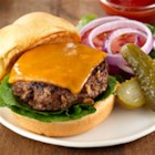Savory Beefy Burgers - Prepared chopped onions and garlic help get these tasty burgers with Cheddar cheese on the table fast, for a quick lunch or weeknight dinner.