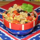 Kerry's Beany Salad - Red and black beans join barley, rice, peppers, and green onions in this robust salad, dressed with a fiery vinegar and oil dressing. Makes a great side dish for ribs or a grilled steak.