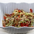 Raw Pad Thai - This colorful raw pad Thai uses zucchini strips as noodles and is coated in an almond butter-based sauce.