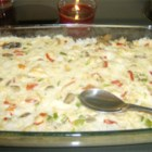 Club Chicken Casserole - This chicken-and-rice casserole is supplemented with canned mushrooms and pimentos.