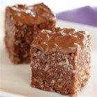 Frosted Chocolate Peanut Butter Treats - Chocolate crisp rice cereal treats get a flavor boost with lots of peanut butter and chocolate mixed in with the melted marshmallows and spread on top.
