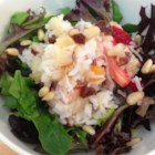 Fruit Rice Salad - A refreshing sweet salad made with fresh fruit, almonds, whipped cream, and coconut. Serve on a bed of lettuce leaves.