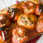 Greek Stuffed Tomatoes and Peppers (Yemista) - Greek stuffed tomatoes and peppers, also known as yemista, are loaded with ground chuck, rice, and onion and drizzled with plenty of olive oil for a crowd-pleasing side dish.