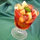 White Wine Fruit Cocktail - Fresh fruit is tossed with a syrup made of white wine, sugar and fresh mint to make a delicious and refreshing treat.