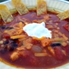 HERDEZ(R) Red Guajillo Chile Chicken Tortilla Soup - Loaded with chicken, black beans, corn, and tomatoes, this tortilla soup is seasoned with a spicy red guajillo cooking sauce for extra kick and flavor.