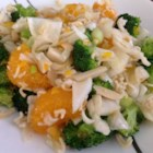 Mad Hatter Salad - A mixture of cole slaw, green onions and broccoli combined with a dry mixture and a delicious dressing to create a wonderful salad that everyone will want the recipe for.  Great for family, church, or barbeque gatherings!
