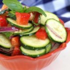 Baby Zucchini Salad - This salad features zucchini, onion, bell pepper, and basil tossed with smoked olive oil and balsamic vinegar.